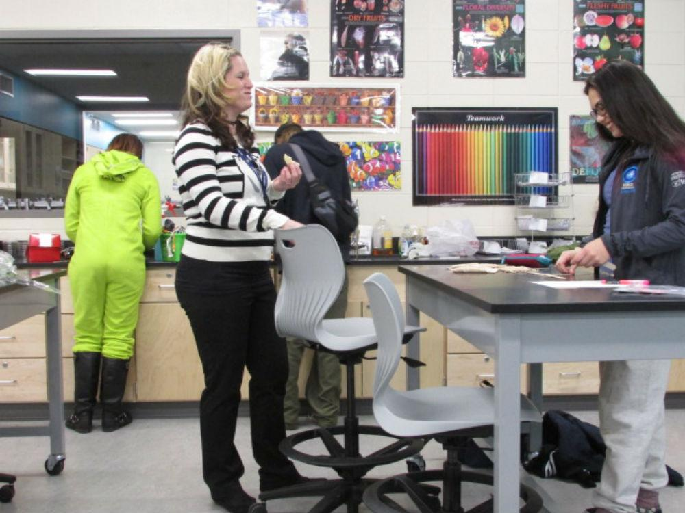 Adviser Corrie Stieglitz and junior Avalon Smith work on crafts during the Horticulture Club holiday party.