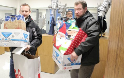 Families receive gifts for the holidays through donations