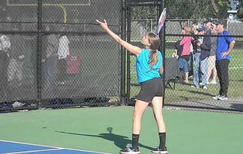 Having full JV and varsity teams is benefiting girls tennis. Sophomore Nichole Coco serves during the Glenbard North quad on Sept. 26.