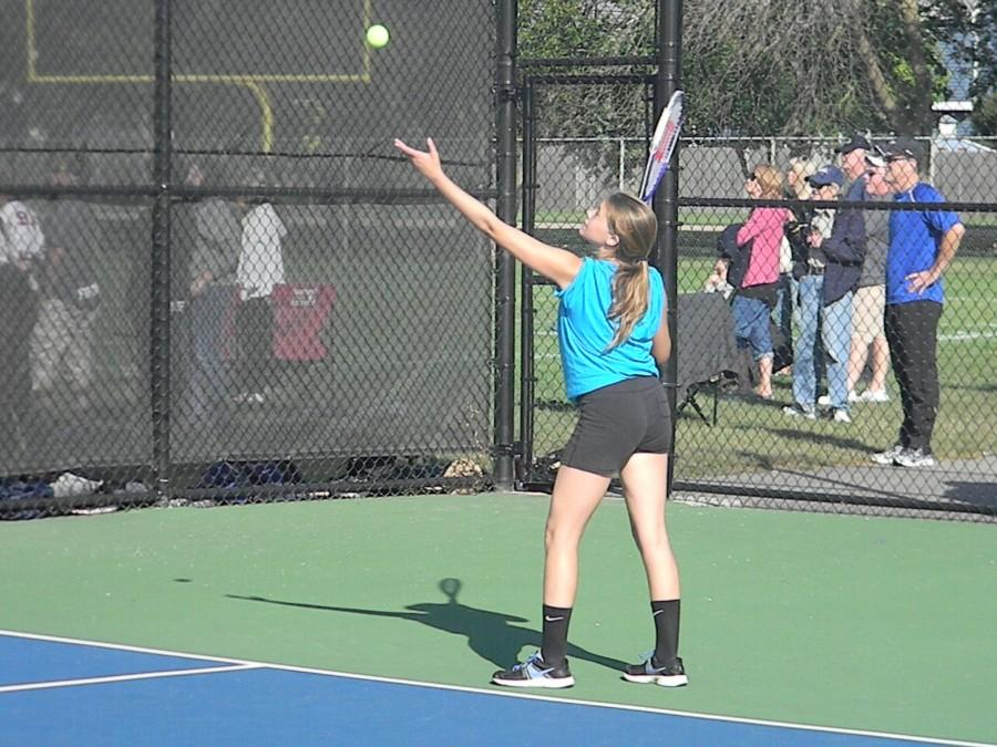 Having+full+JV+and+varsity+teams+is+benefiting+girls+tennis.+Sophomore+Nichole+Coco+serves+during+the+Glenbard+North+quad+on+Sept.+26.+