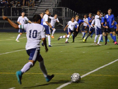 Focus on mental toughness and teamwork helps the team improve its record. Junior Eduardo Suarez shots a corner kick against St. Charles North.