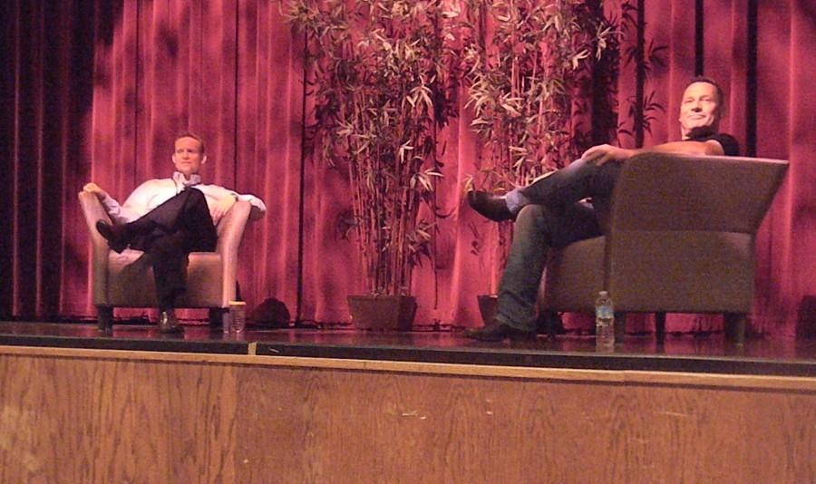Class of 1982 graduate Ray Stejskal received the Distinguished Alumni Award on Oct. 1. Stejskal (right) discusses his time at the school with Marc Wolfe in front of students in the auditorium.