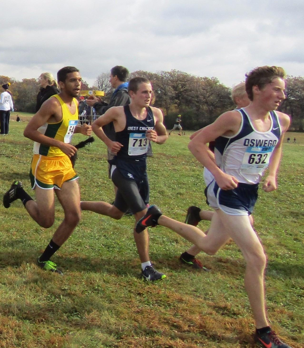 Junior Danny McComb (center) finished 14th out of 62 runners at the regional meet hosted by West Chicago to qualify for sectionals. His finishing time was 15:50.4.