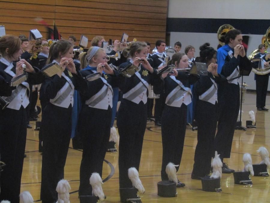 Marching season is over after the final performance given on Oct. 26. Senior players were recognized by wearing blue capes during the showcase.