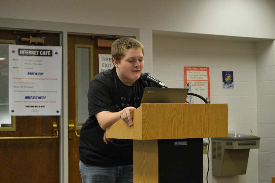 Creative Writing members get a chance to share works at monthly open mic events. Senior member Noah Clark speaks at the November open mic.