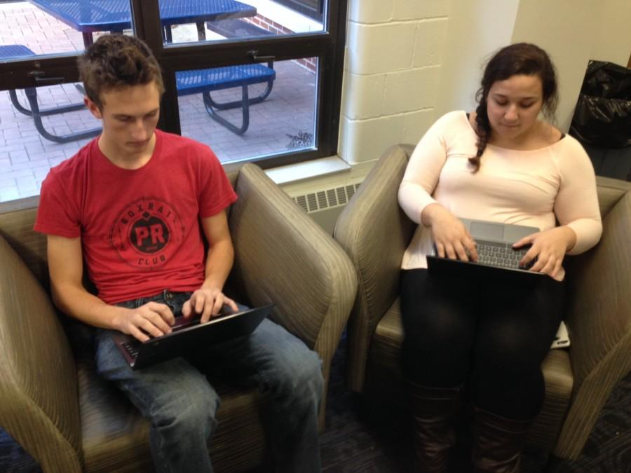 Several steps to prepare for e-learning are present around the school. Seniors Jacob Watkins and Alena Troia take advantage of the wireless internet access granted to students throughout the building.