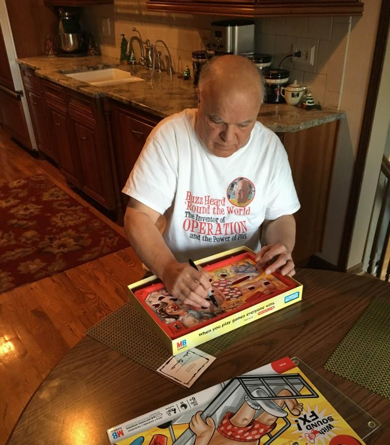 The inspiration for Operation came from Spinello shocking himself as a child. Spinello signs a copy of the board game in his home.