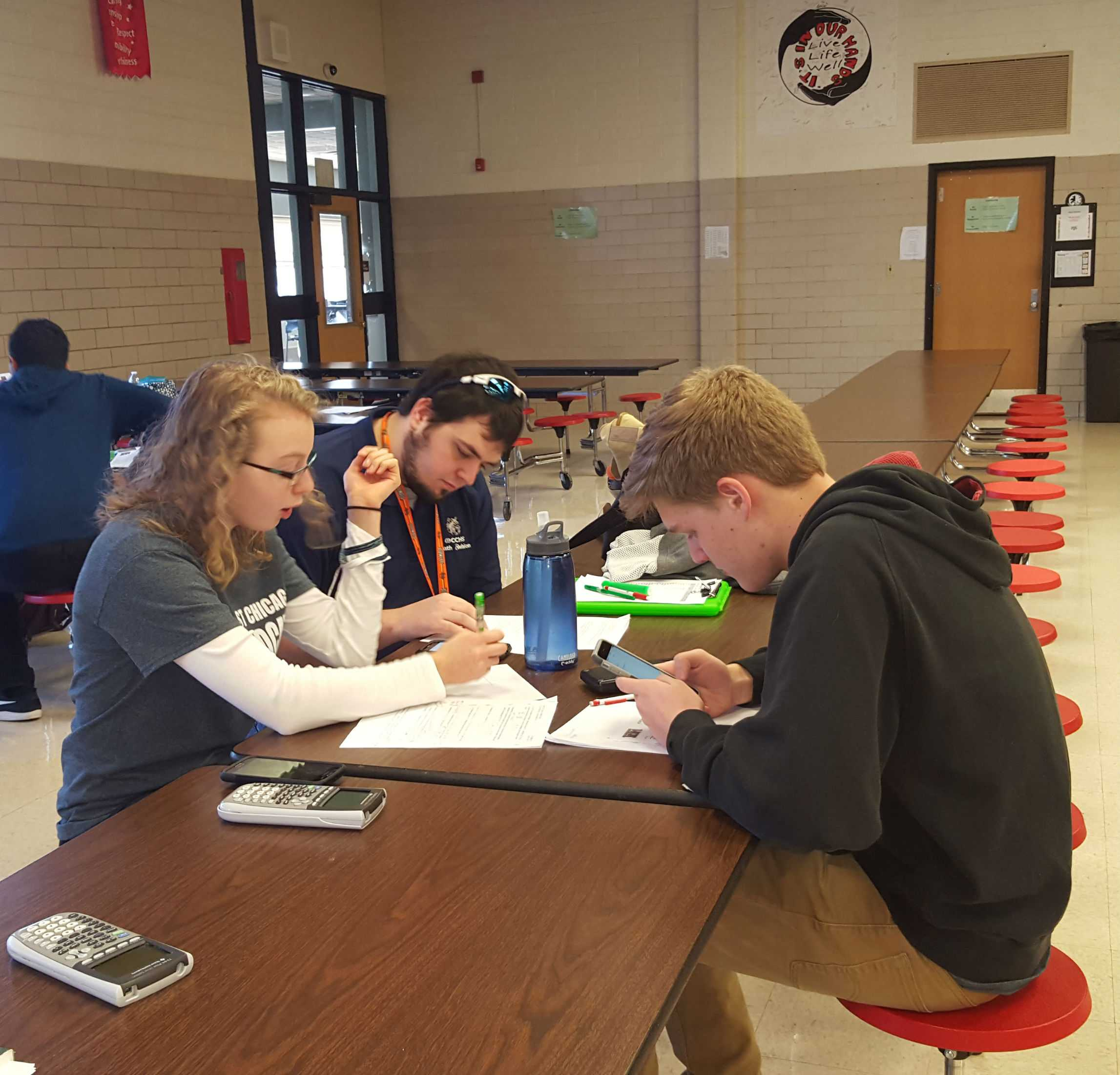 Regionals for math were held at Batavia High School against eight other schools. Math teacher Charles Vokes helps juniors Jenna Palka and David McGhee prepare for a test.