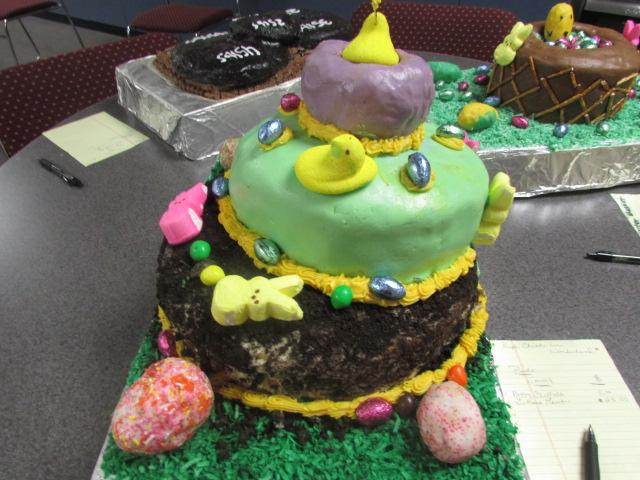The auction for several cakes made by foods 3 ends Friday at noon. Purple chick in wonderland is one of the cakes up for auction
