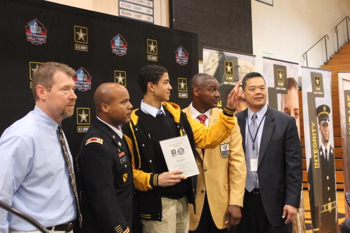 As one of 20 finalists of the U.S. Army Award for Excellence, junior Tai Bibbs (center) was honored at the school's spring assembly. He will be part of the Pro Football Hall of Fame Enshrinement festivities where the winner will be announced.