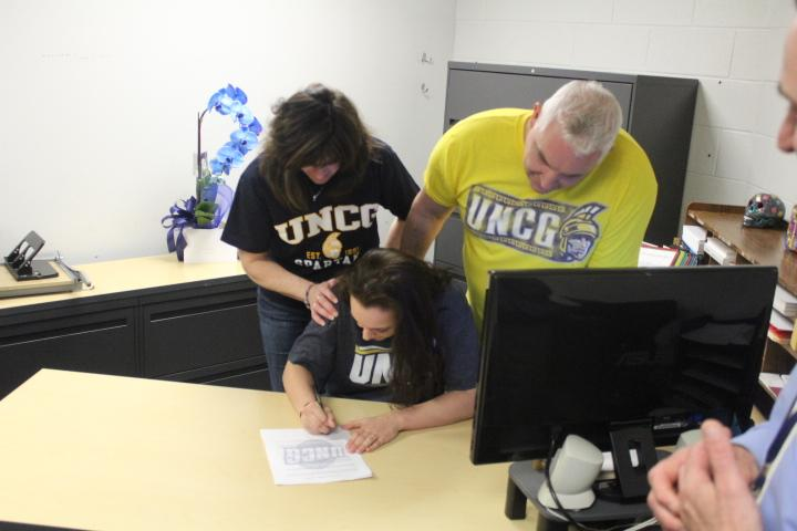 Senior girls volleyball player Ronni Katarzynski signs her intent to play at the University of North Carolina at Greensboro. She will play as a libero for the team.