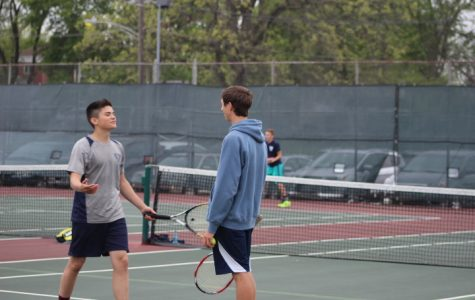 First doubles junior Daniel Lamperis and senior Kyle Gravit celebrating during a match against West Aurora.