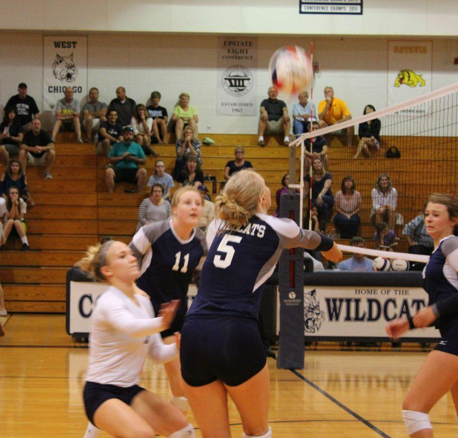 Junior Maggie Smith hits the ball over the net against East Aurora. The team won against East Aurora.