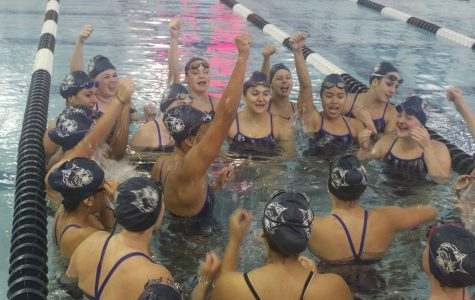 The girls swim team is expecting state qualifiers for this season. Senior Natalie Nelson pumps up the team during their meet against Elgin.