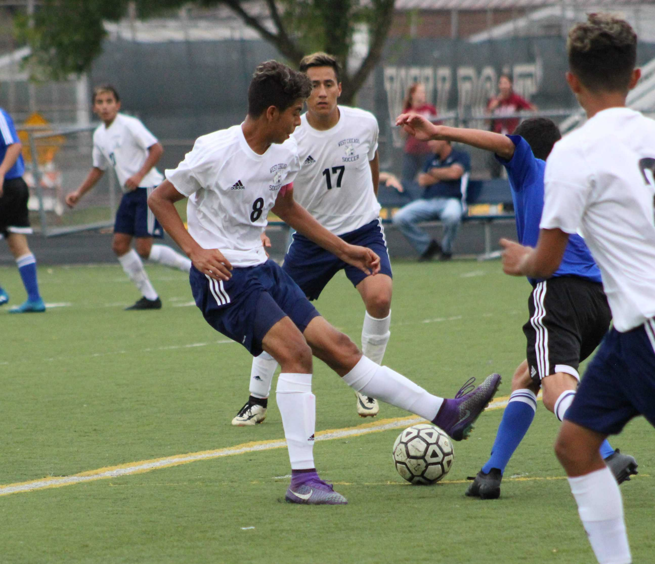 Senior Edgar Pani passes the ball back to senior Guillermo Orizaba, who then takes a shot on net. The teams next home game is Oct. 4 against Bartlett.