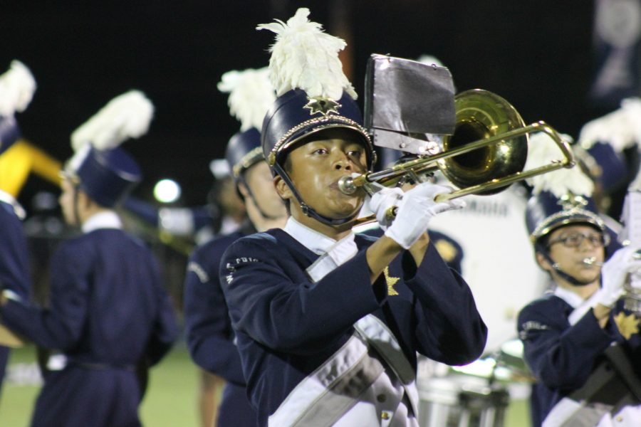 The WeGo music program receives a $25,000 grant towards new instruments. Junior Luke Madden playing the trombone at Fridays football game.