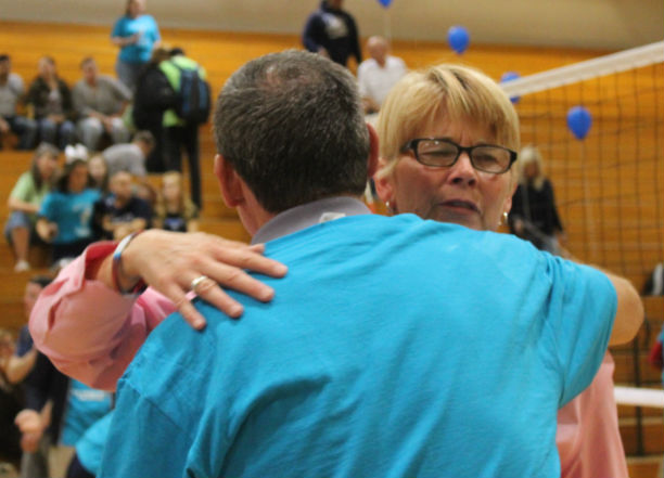 Students and staff came together to support volleyball coach Kris Hasty. Athletic director Doug Mullaney congratulates coach Hasty.