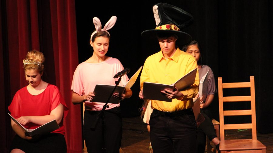 Junior Natalie Thompson (left) and junior Ricky Gieser (right) performing in drama clubs live radio show on Saturday. Their next performance will be Peter and the Starcatcher on Nov. 11, 12, and 13.