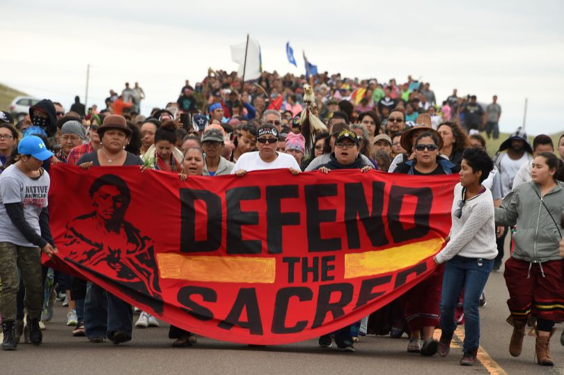 Native Americans march to the site of a sacred burial ground in North Dakota to protest of oil pipeline that will cross the nearby Missouri River.