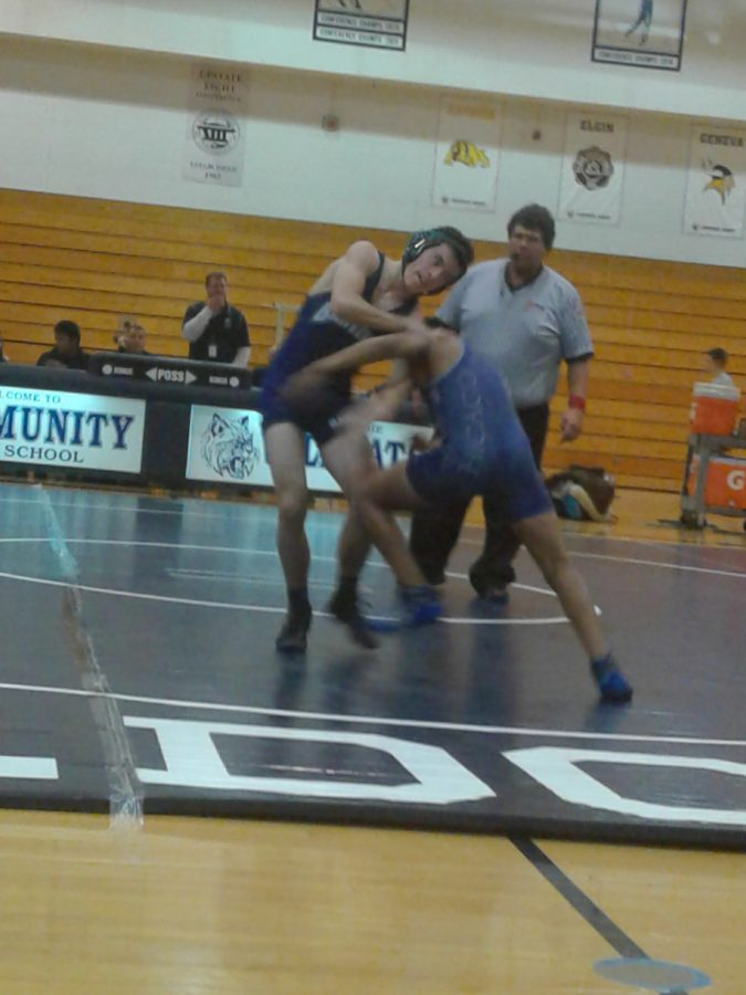 Freshman  Eduardo Cholula  takes down his opponent. Both teams ended with a score of 36 points.