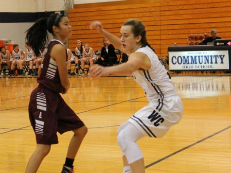 Junior Sierra Koenig goes after the ball before getting injured in the game against Elgin. The team won 54-22 Tuesday.