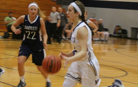 Junior Sierra Koenig dribbles the ball. The team lost 47-34.