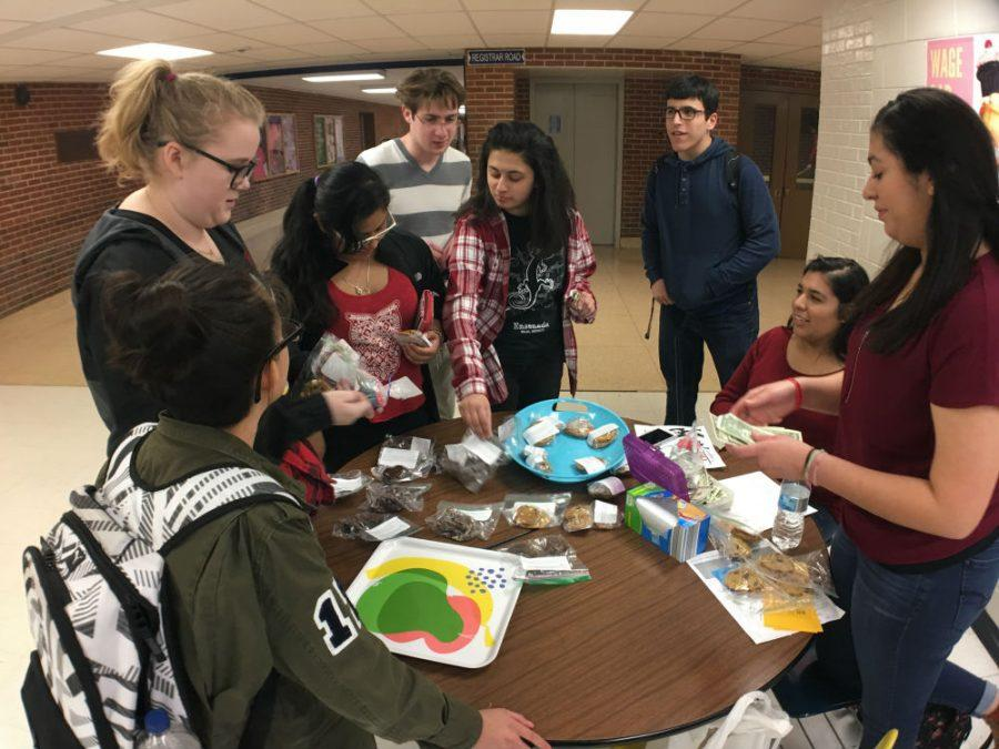 WeGo Global designated March as a month to advocate for women's rights. On March 8, International Women's Day, WeGo Global and French teacher Lindsey Evans set up a wage gap bake sale.