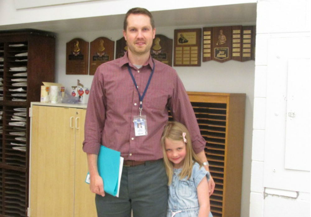 Maddy Govertsen and her dad, band director Stephen Govertsen pose.