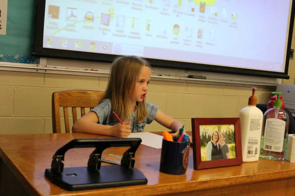 Maddy Govertsen, daughter of Spanish teacher Beth Govertsen, introduces herself to the  class.