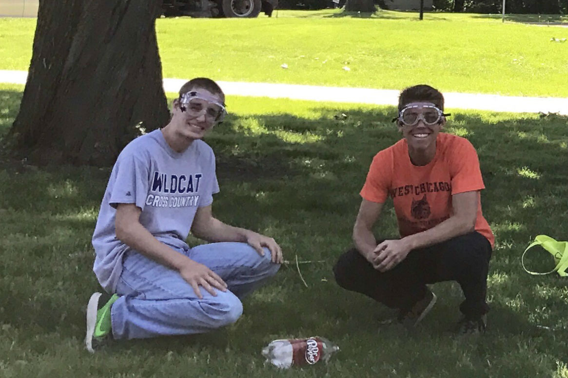 Senior Daniel McComb (left) and junior Zenen Cardenas (right) pose next to their rocket on Tuesday. The rocket experiment is an AP chemistry tradition conducted every year.
