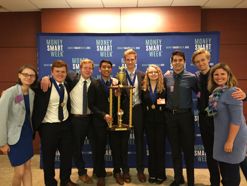 The Illinois Personal Finance Challenge team was one of the only schools to have two teams place in the top ten at state. From left  junior Emily Pietura, junior Mike Sawicki, senior Patrick McCormack, junior Jeremy Belington, senior Ross Behr, senior Jenna Palka, senior Elijah Pinkevich, senior Christian O'neil, and economics teacher Candace Fikis.