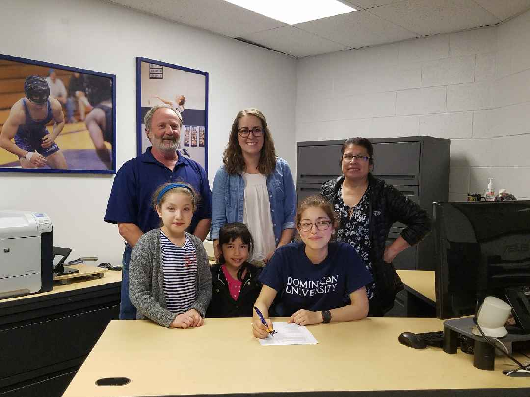 Senior cross country runner Esmeralda Navarro signs her intent to run at Dominican University.