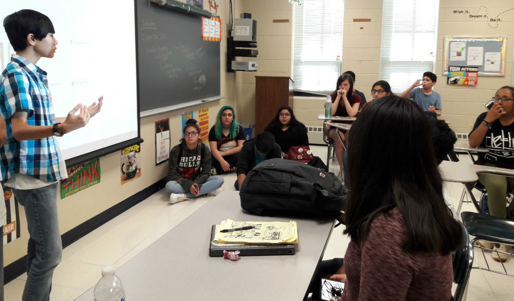 Senior Johnny Nguyen explains the club issue regarding the suspension of all volunteer teachers from running their clubs to the Anime Club members on Aug. 22. Anime Club is one of the clubs that is suspending its meetings.