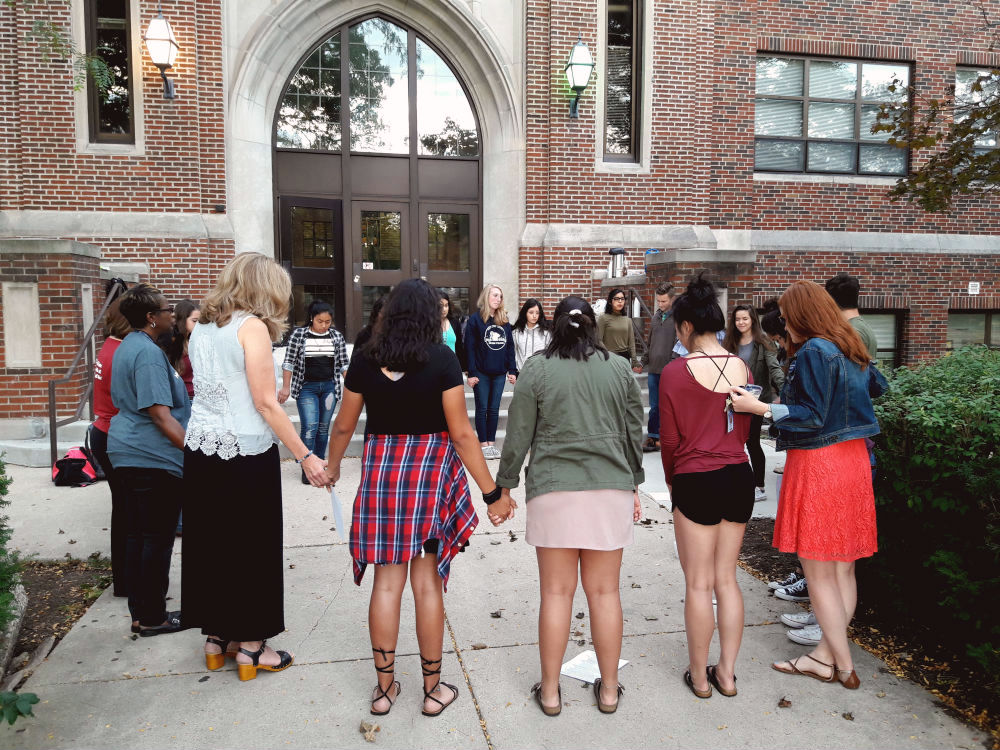 Participants and Compass members pray for the world and school.