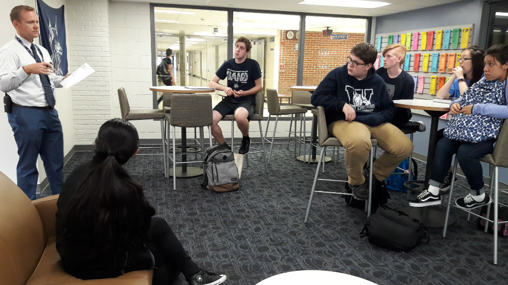 On Tuesday, activities director Marc Wolfe offers suggestions to students about how to continue volunteer clubs without teacher support. Principal Moses Cheng also participated.