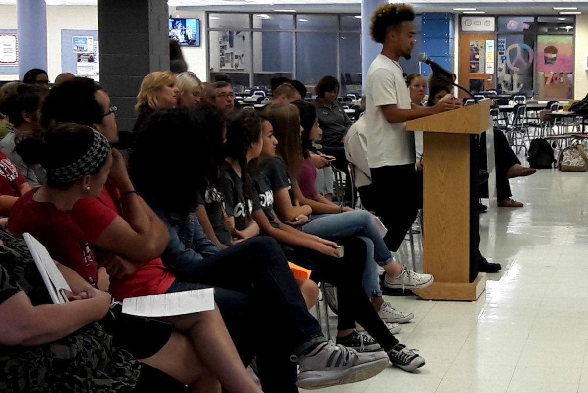 Senior Joseph Tate speaks on behalf of Anime Club during the Board of Education meeting Tuesday.