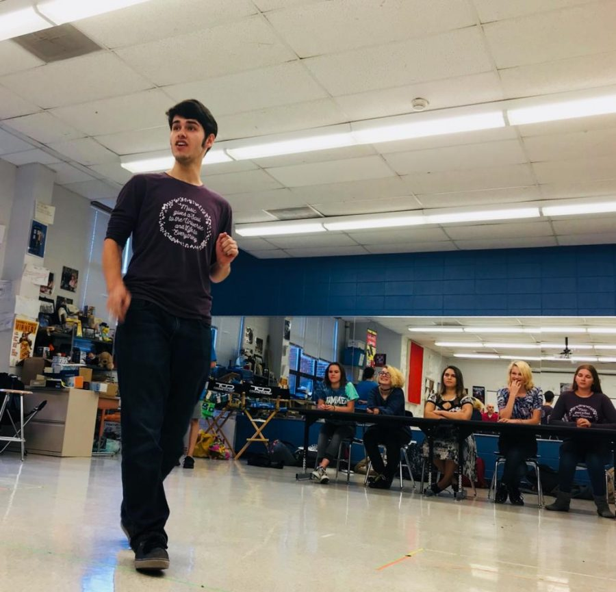 Senior Ricky Gieser, who plays the role of a maître d', rehearses for the play only on Saturday.