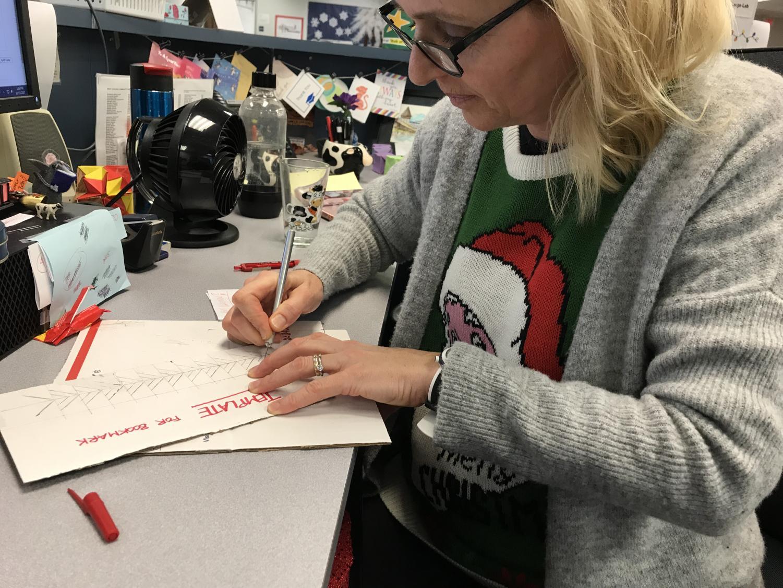 LRC clerk Britta Renwick working on a bookmark.