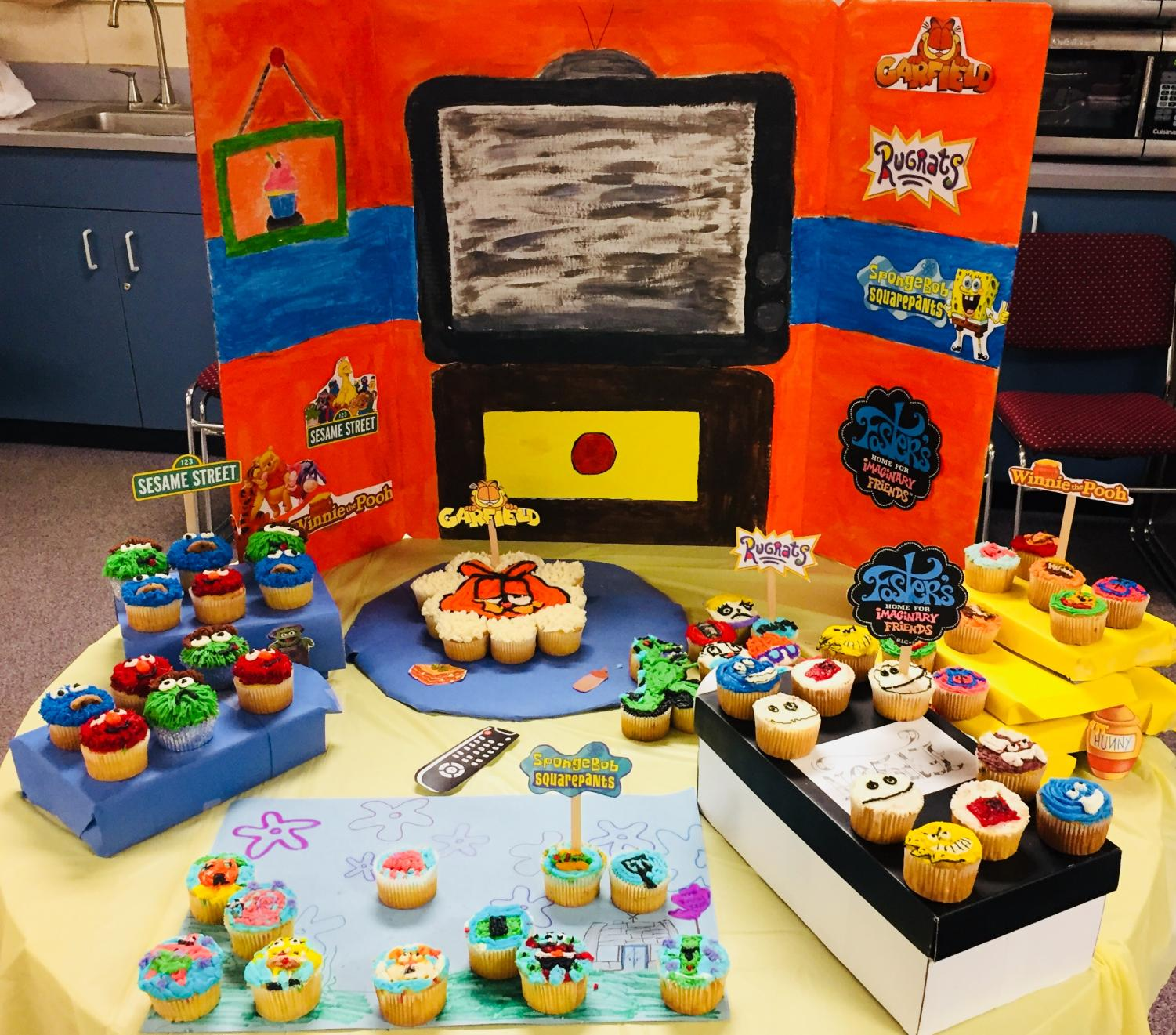Kids' TV shows themed entry of the annual cupcake war wins first place.