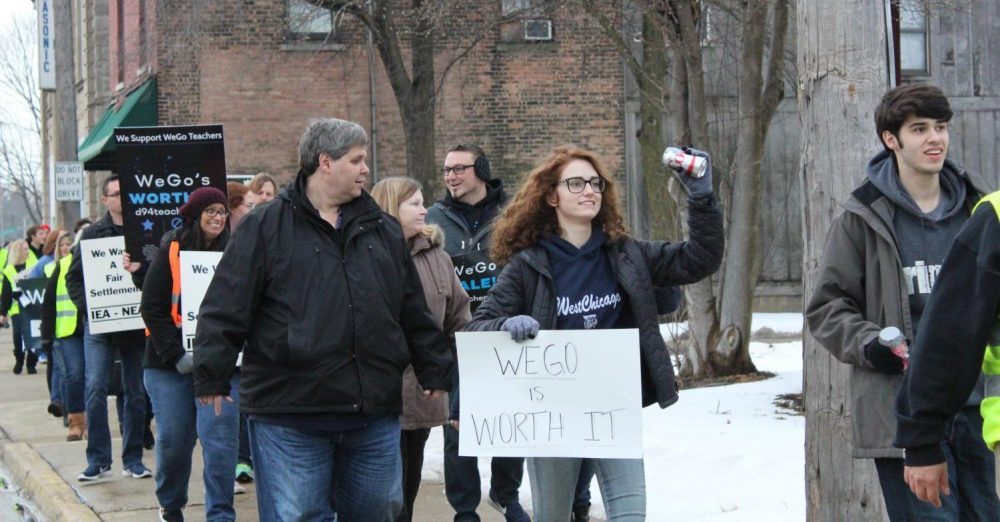 West Chicago Teachers' Association members, students, and community members march to the district office on Thursday.