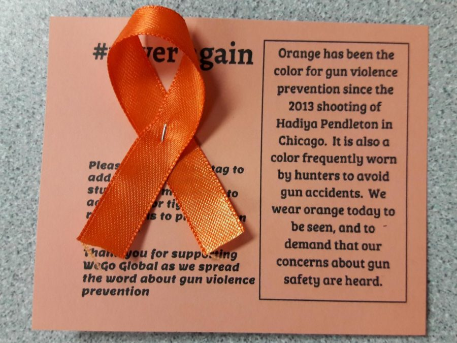 WeGo+Global+will+be+handing+out+ribbons+with+information+regarding+gun+violence+prevention+on+Wednesday.+