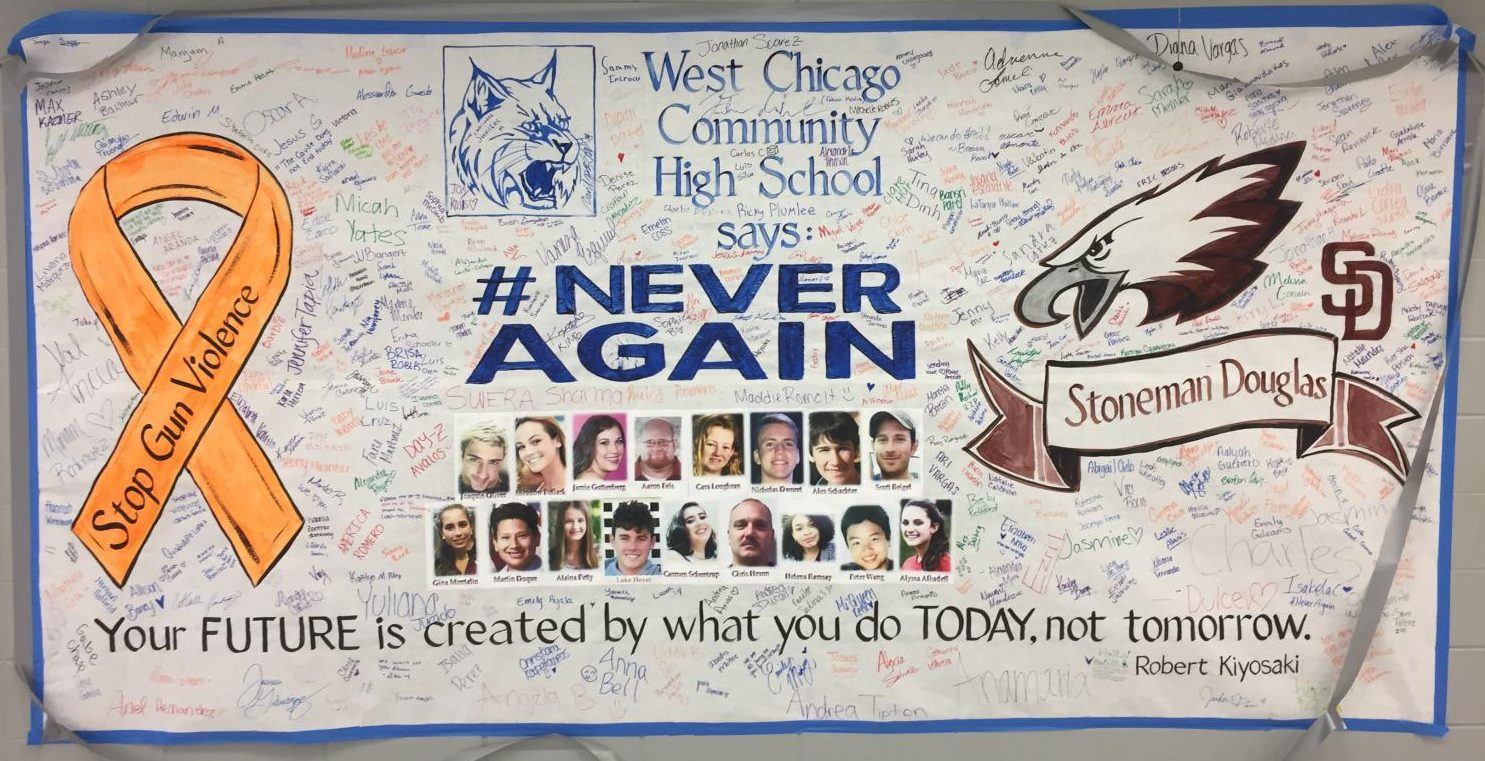 WeGo Global hung up a banner, made by art teacher David Exner, for Marjory Stoneman Douglas High School victims. Students were encouraged to sign the banner and write comments on it.