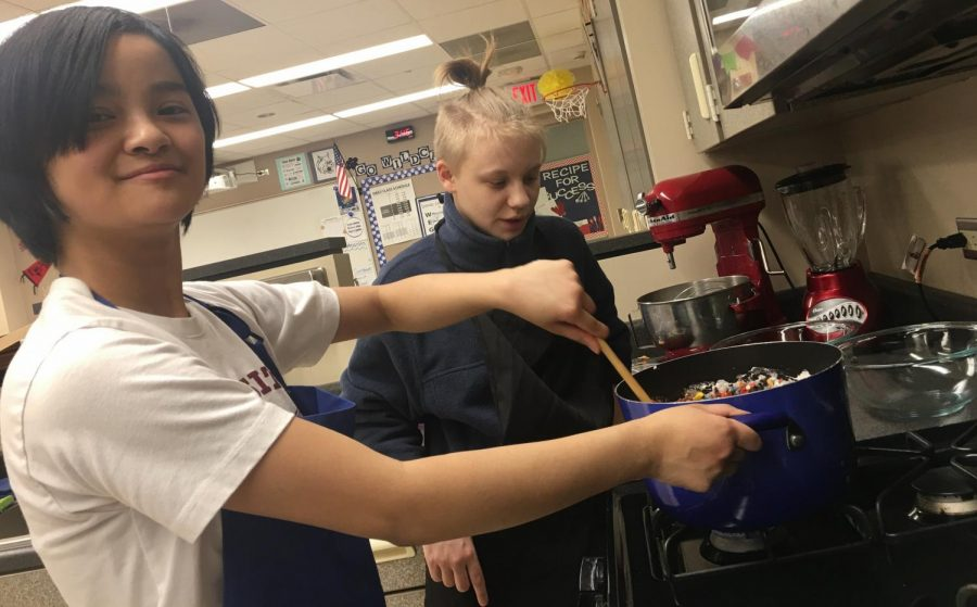 Freshman Cielo Cabael-Castro and Freshman Kem Jaloway bake rainbow rice krispies in the family and consumer science kitchens.