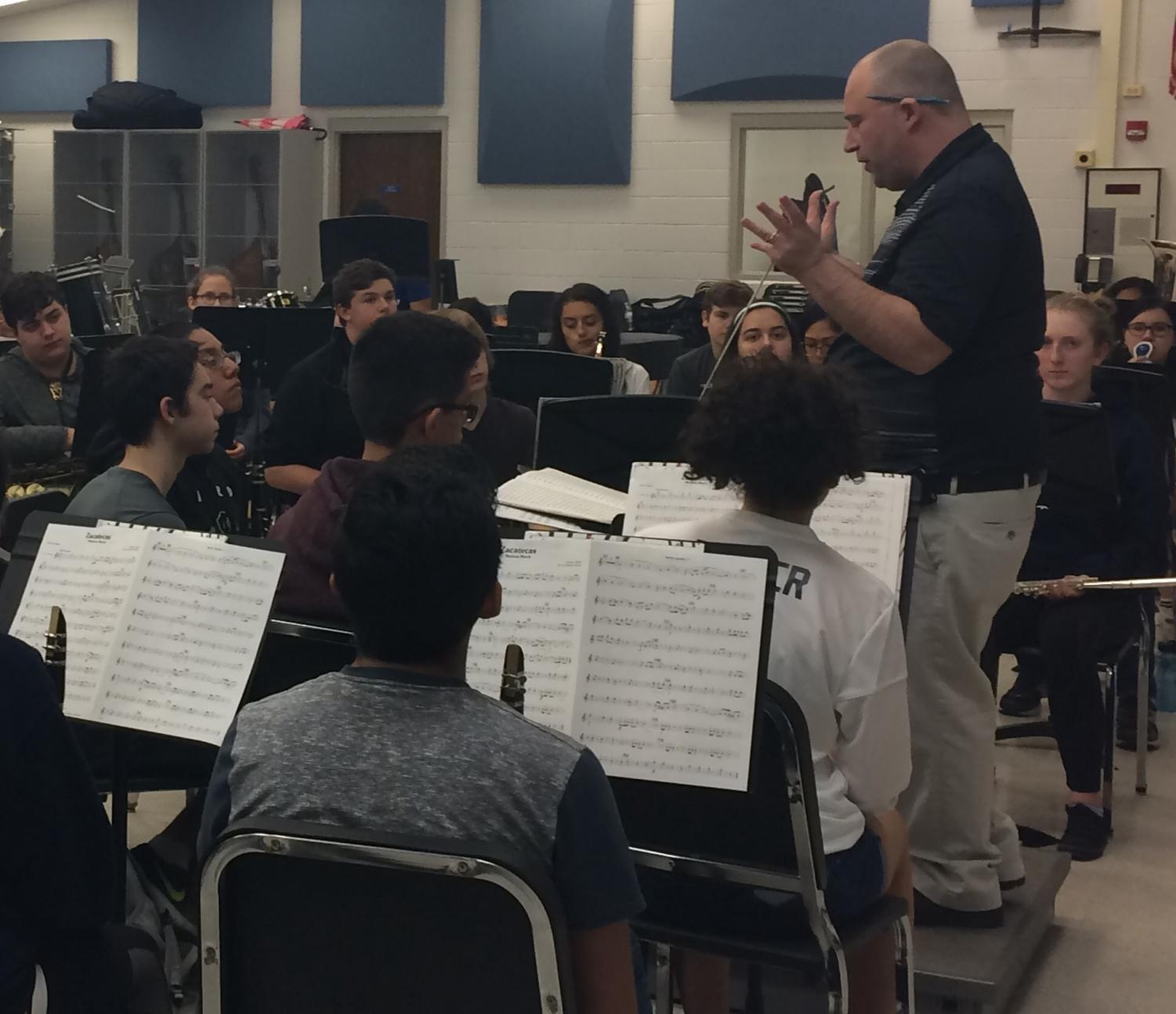Band director James Wallace prepares students for the last band concert of the year on Wednesday in the auditorium.