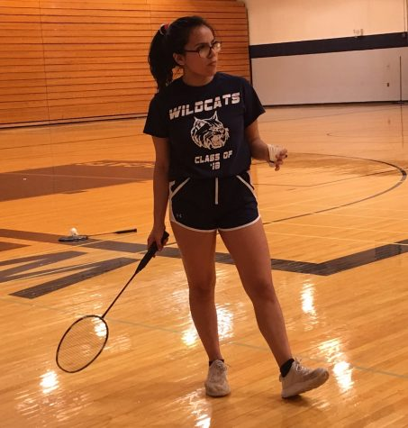 Badminton team captain Clarissa Vargas practices with her team in the Bishop gym.