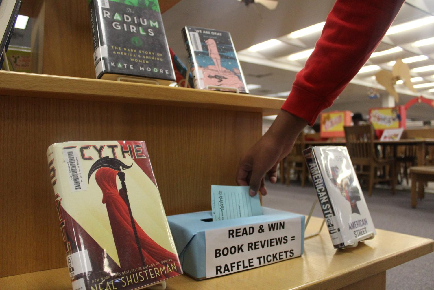 Students can submit their book reviews for a chance to win a gift card