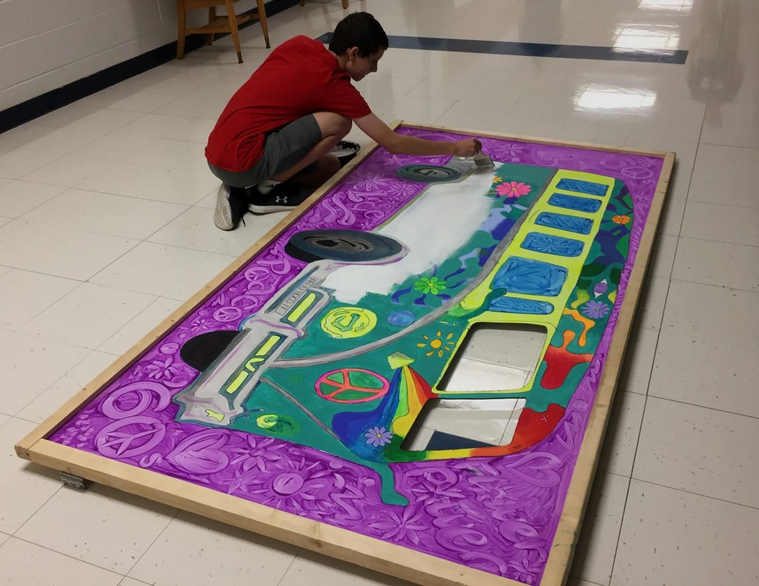 Art Club member, sophomore Ryan McComb, prepares banners for homecoming.