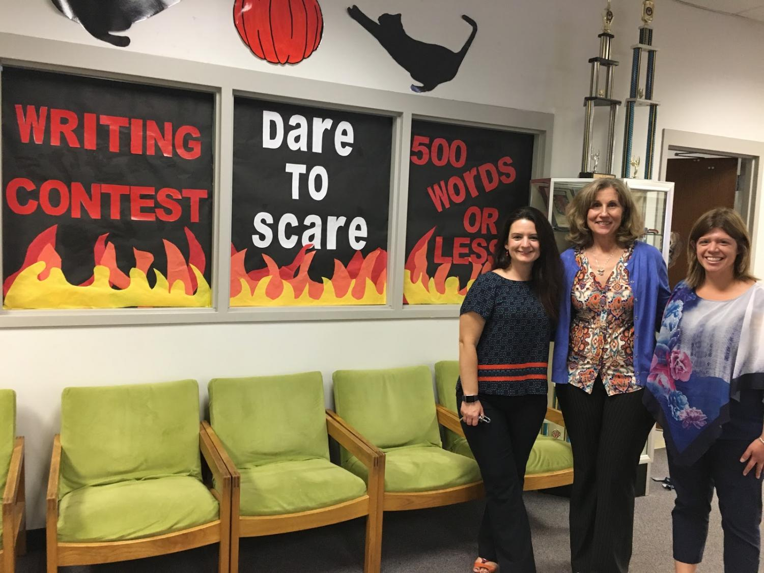 The Dare to Scare contest is now open and students can submit their stories to their English teacher or the LRC. From left, language arts teacher Tara Deleon, library media specialist Donna Leahy, and career and technical education teacher Brittney Bauer will take part in the event.