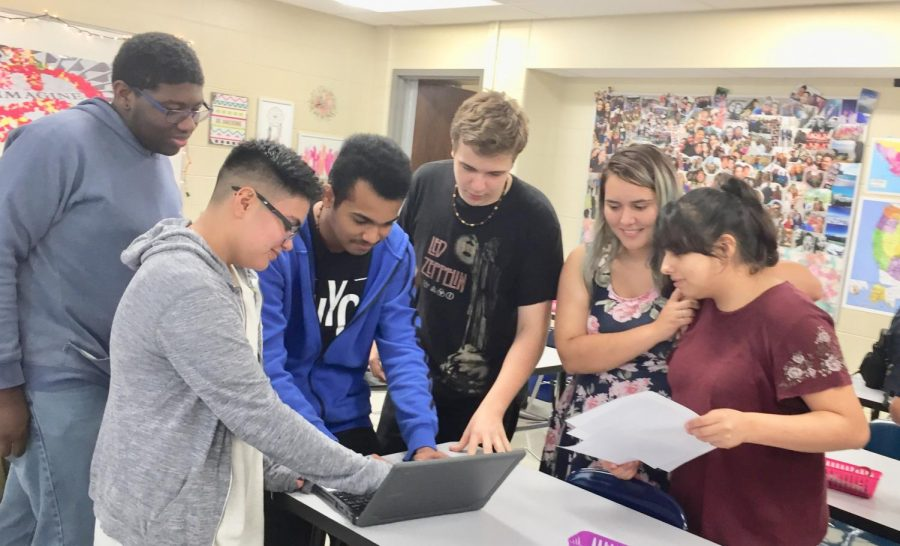 Creative Writing Club members, from left, seniors Aaron Sexton-Abdullah, Ace Avila, freshmen Abil Vellikara and Quentin Stone, seniors Nora Zamora and Delia Garcia prepare written pieces for Thursday's Open Mic night.