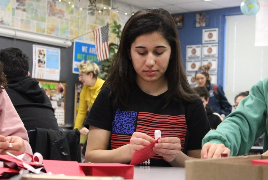 "Junior Ameena AlHammo uses her experience escaping ISIS to inform the community about her people. She makes information cards for ""On Her Shoulders"" screening which took place Feb 1."